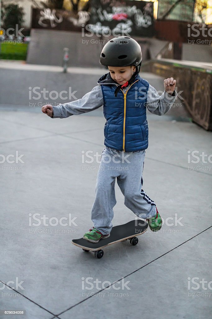 Boy with skate stock photo