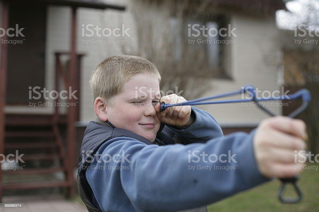 Boy with Slingshot royalty-free stock photo
