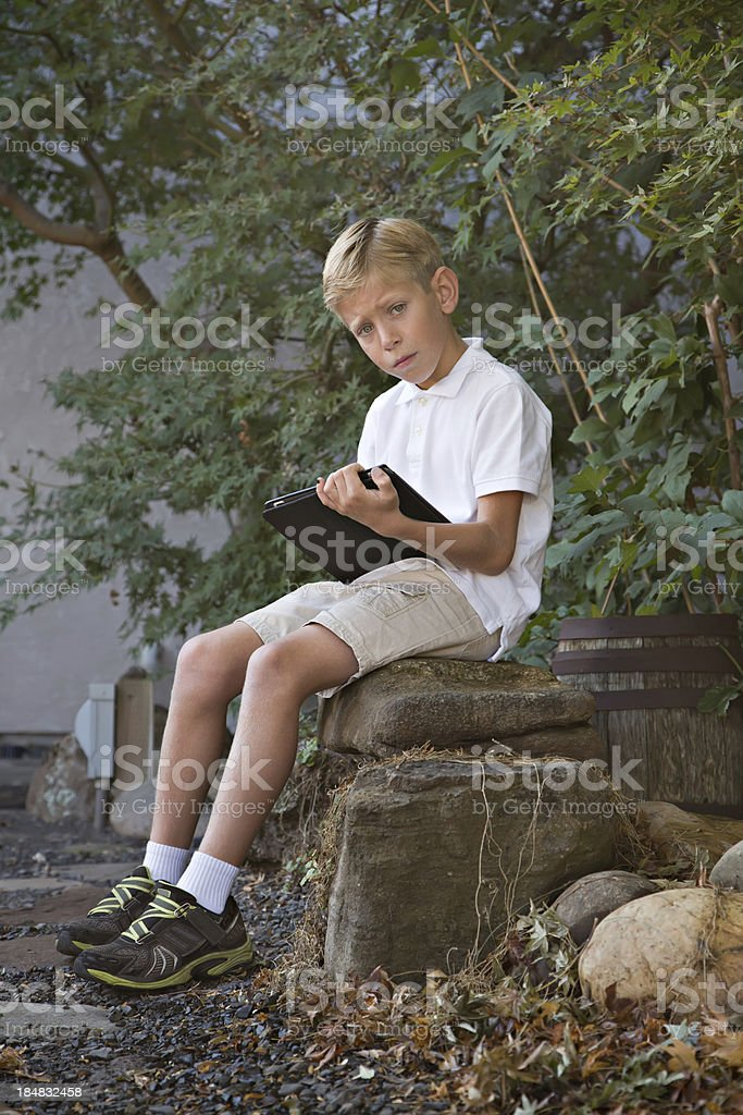 Boy With Smart Pad Tablet royalty-free stock photo