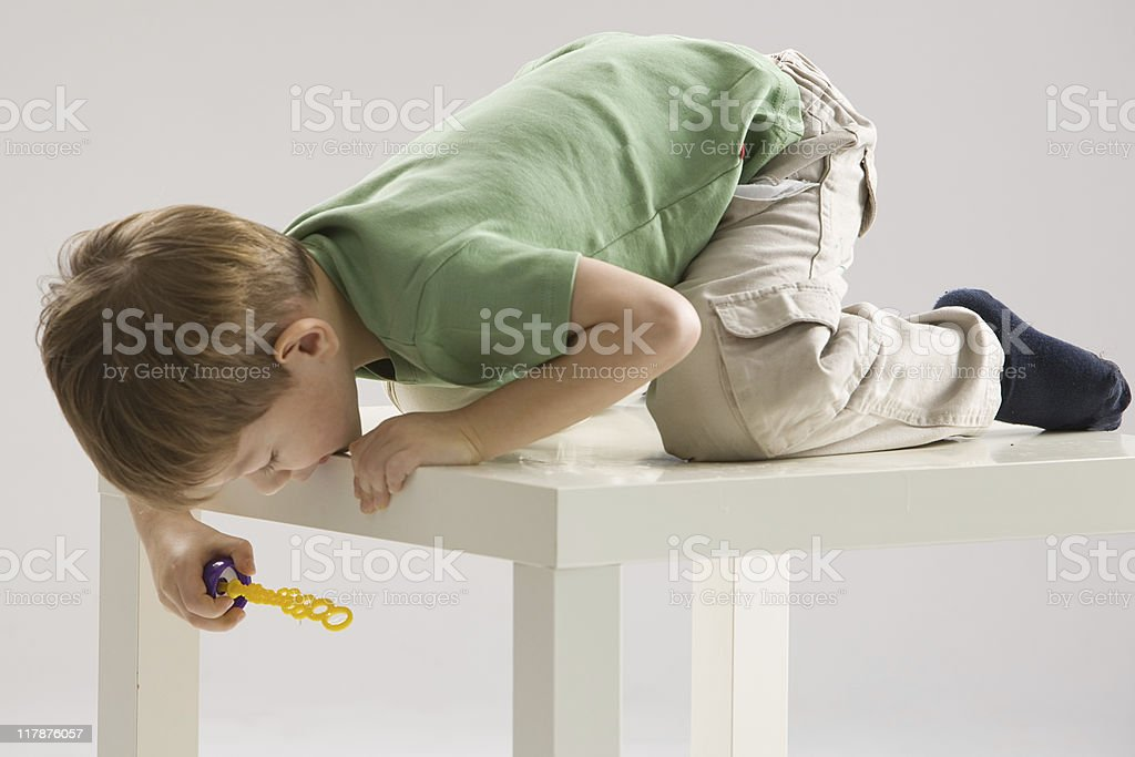 boy with soap bubbles stock photo