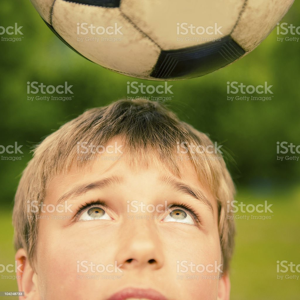 boy with soccer ball royalty-free stock photo