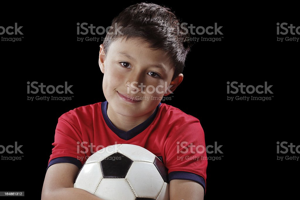 Boy with soccerball on black background royalty-free stock photo