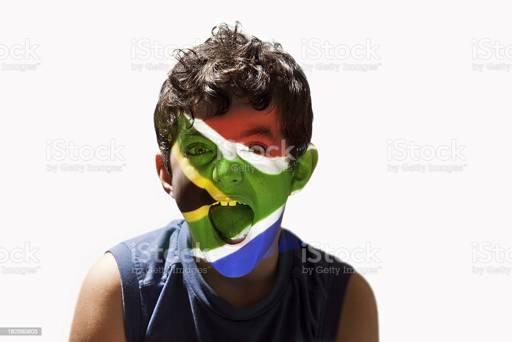 Boy with south african flag on face royalty-free stock photo