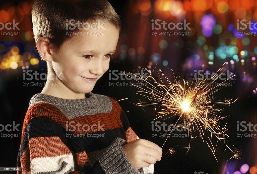 Boy with sparkler stock photo