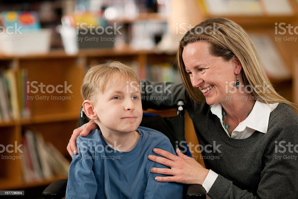 Boy with special needs stock photo