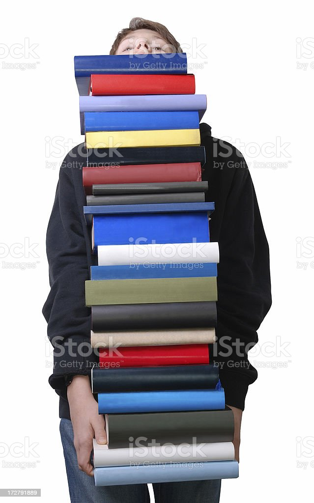 Boy with stack of books royalty-free stock photo