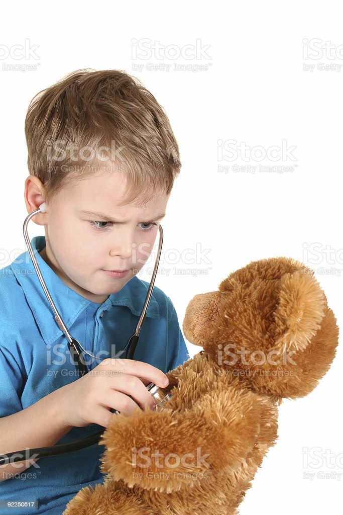 boy with stethoscope and toy royalty-free stock photo