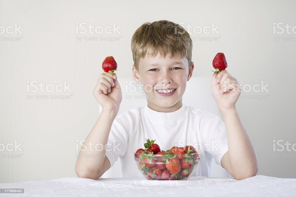 boy with strawberries royalty-free stock photo
