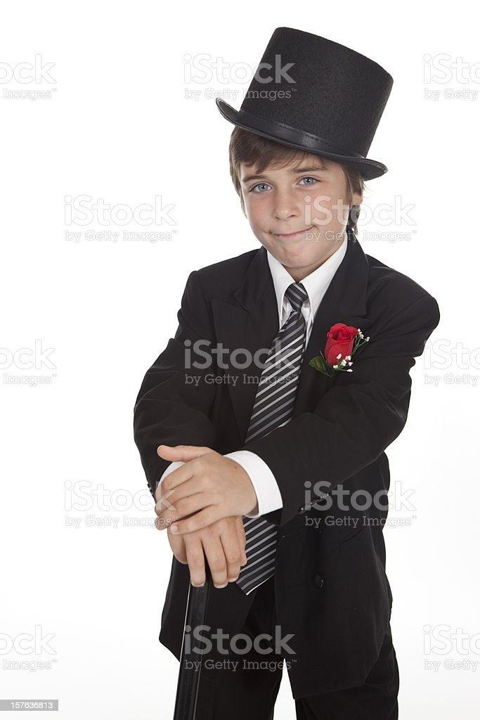 Boy With  Suit, Top Hat, Cane,a wry look. stock photo