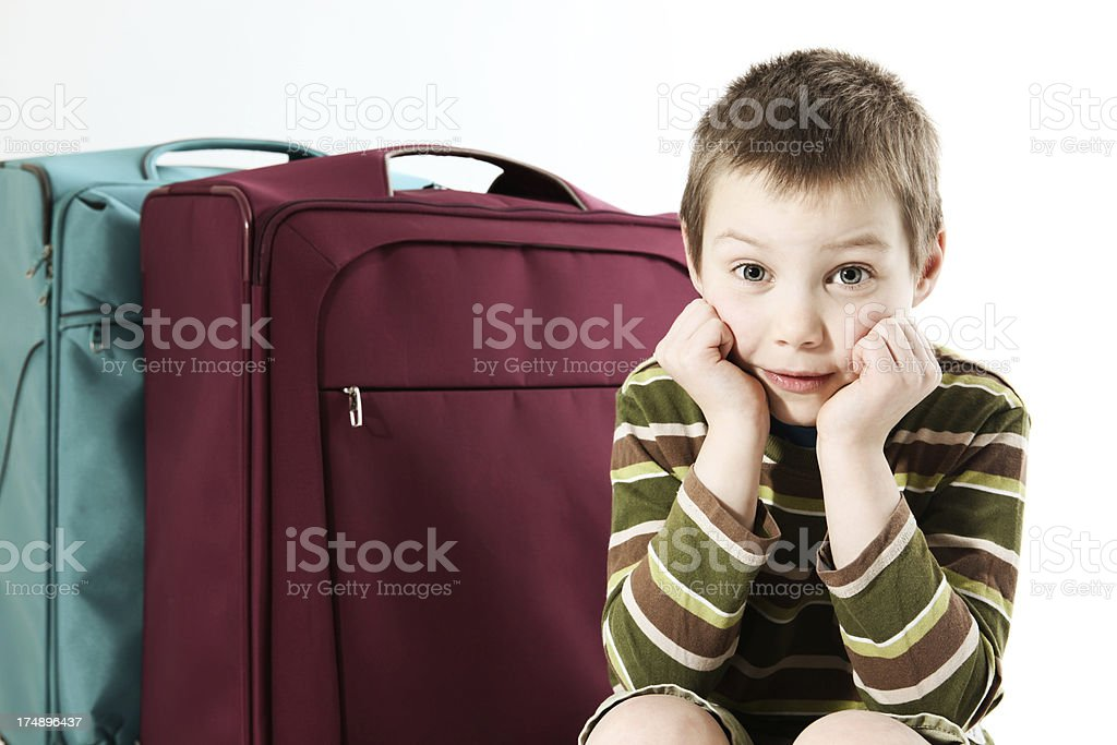 boy with suitcases royalty-free stock photo
