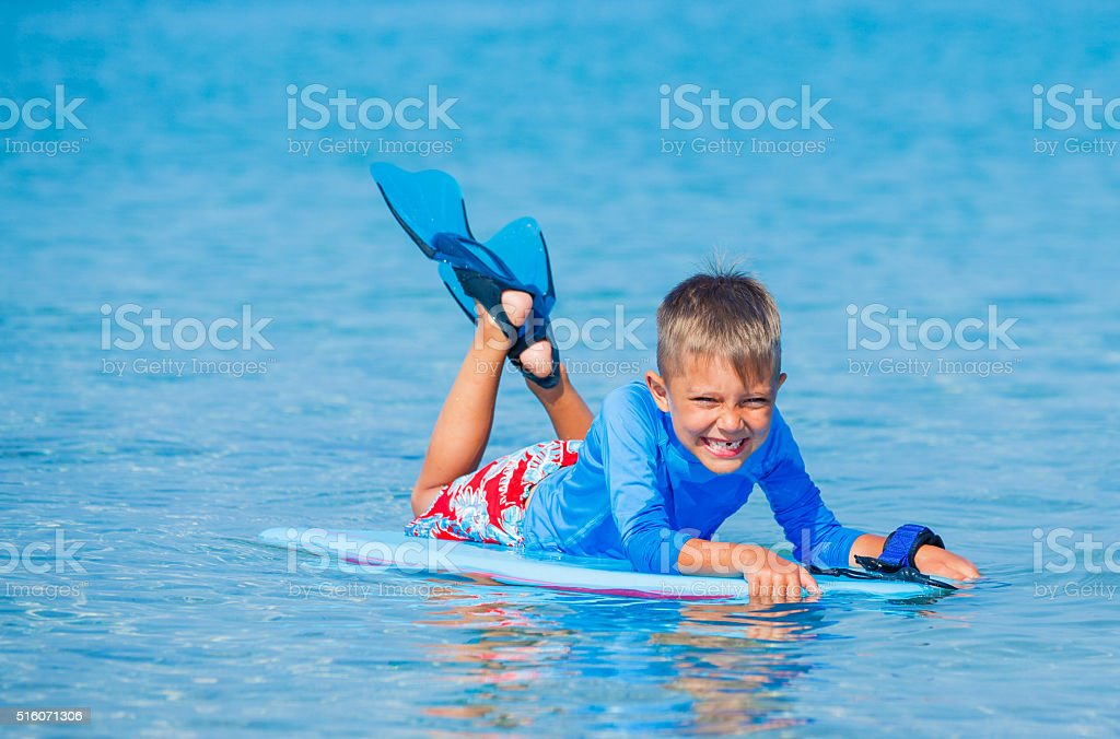 Boy with surf stock photo