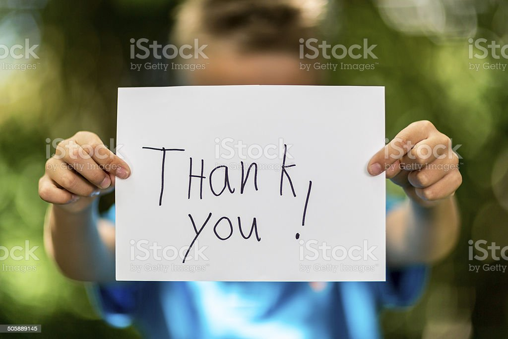 Boy with Thank You sign stock photo