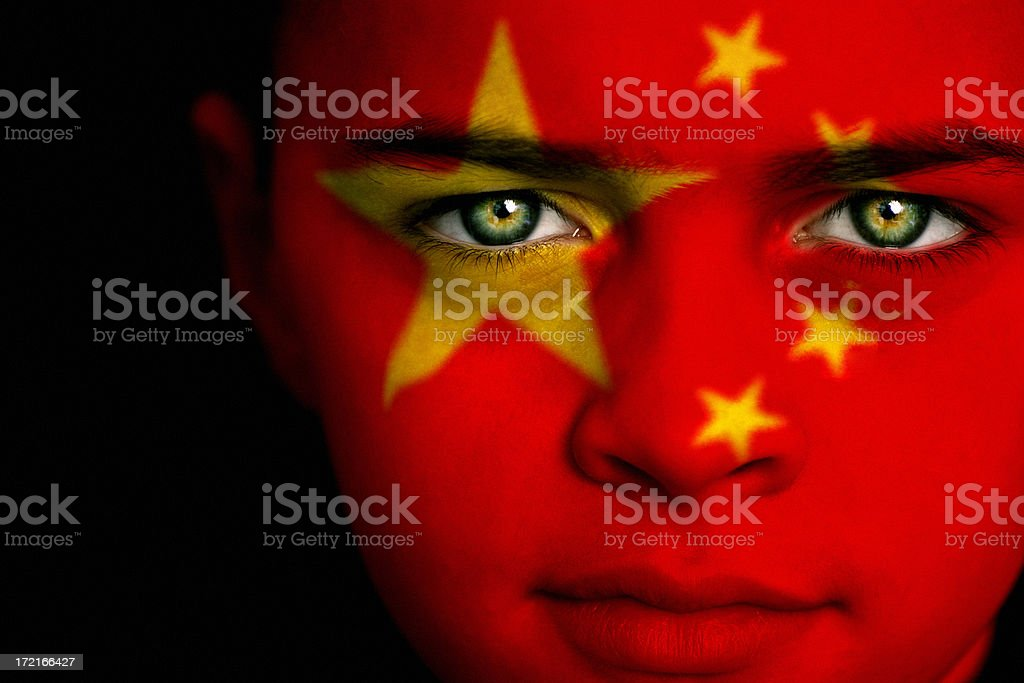 Boy with the flag of China painted on his face royalty-free stock photo