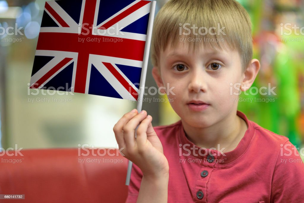 Boy with the UK flag stock photo