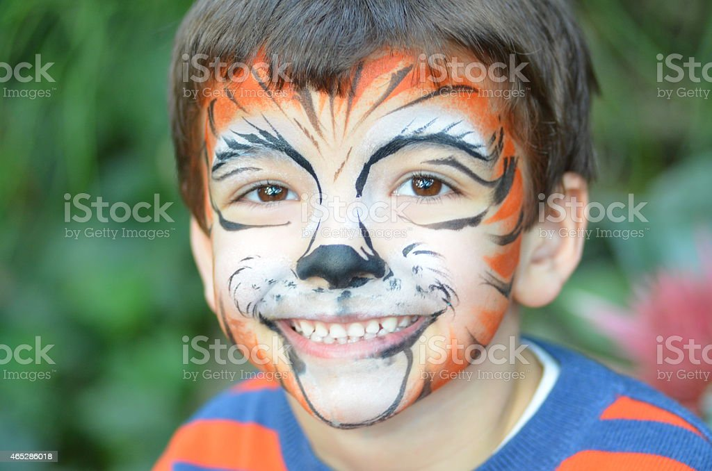 Boy With Tiger Face stock photo