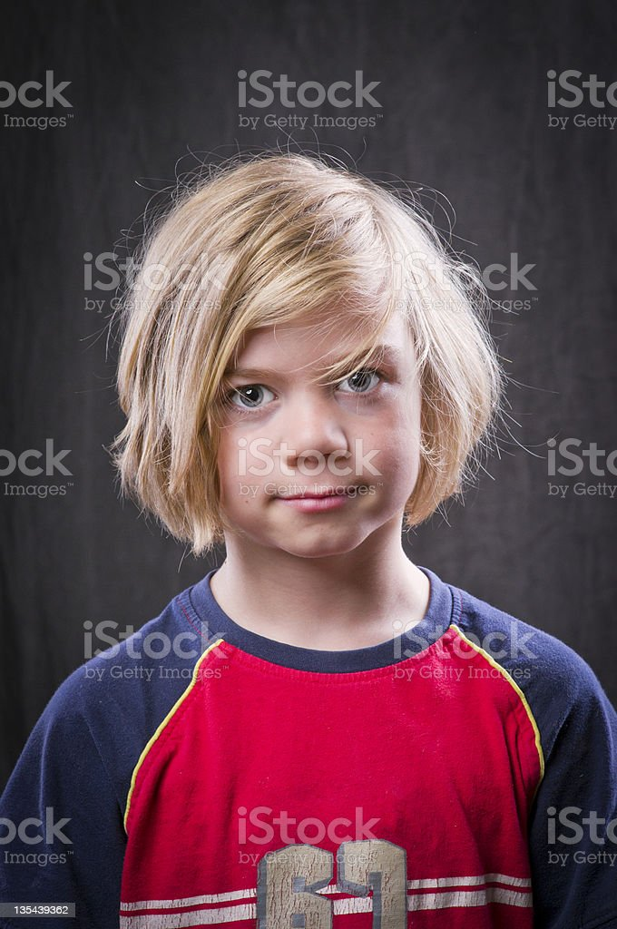 Boy with totally toused hair stock photo