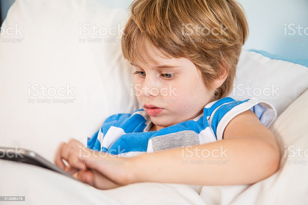 Boy with touchpad tablet Learing playing stock photo