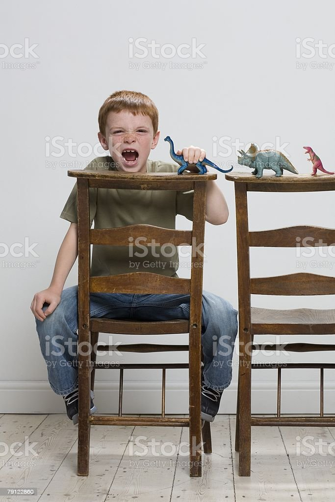 Boy with toy dinosaurs royalty-free stock photo