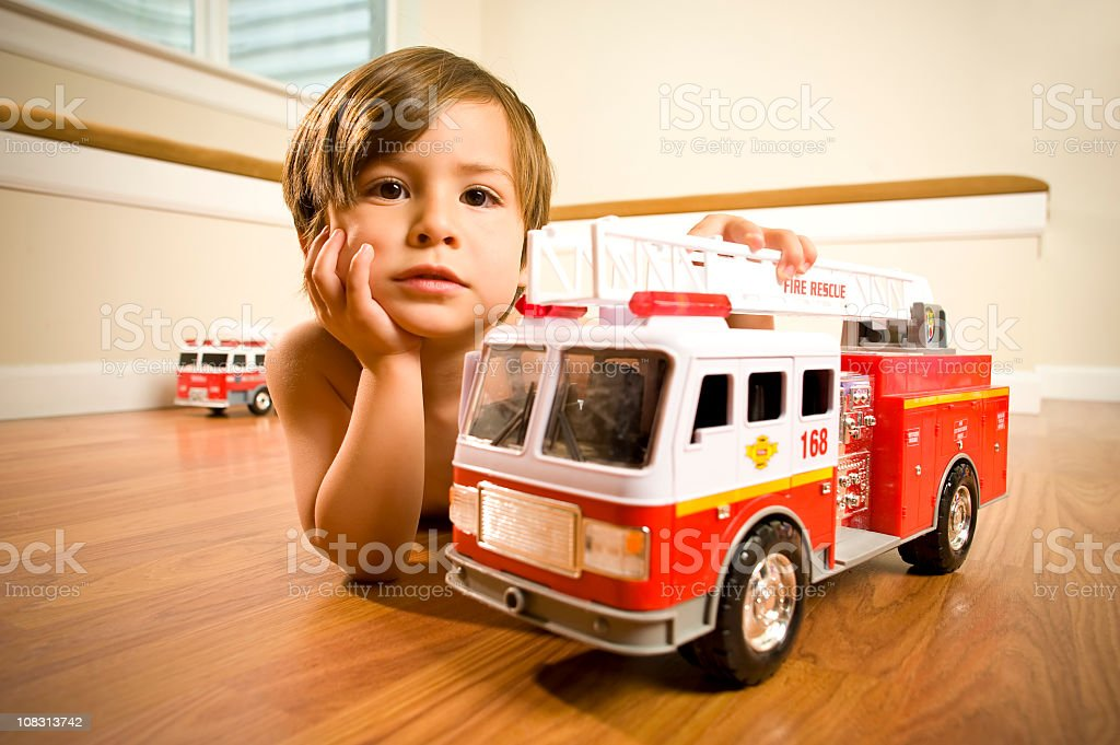 Boy with toy fire trucks royalty-free stock photo