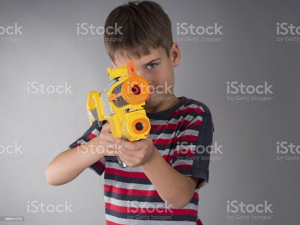 boy with toy gun royalty-free stock photo