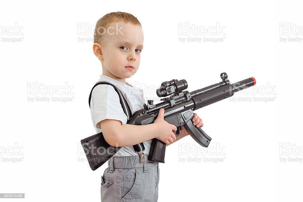 Boy with toy gun stock photo