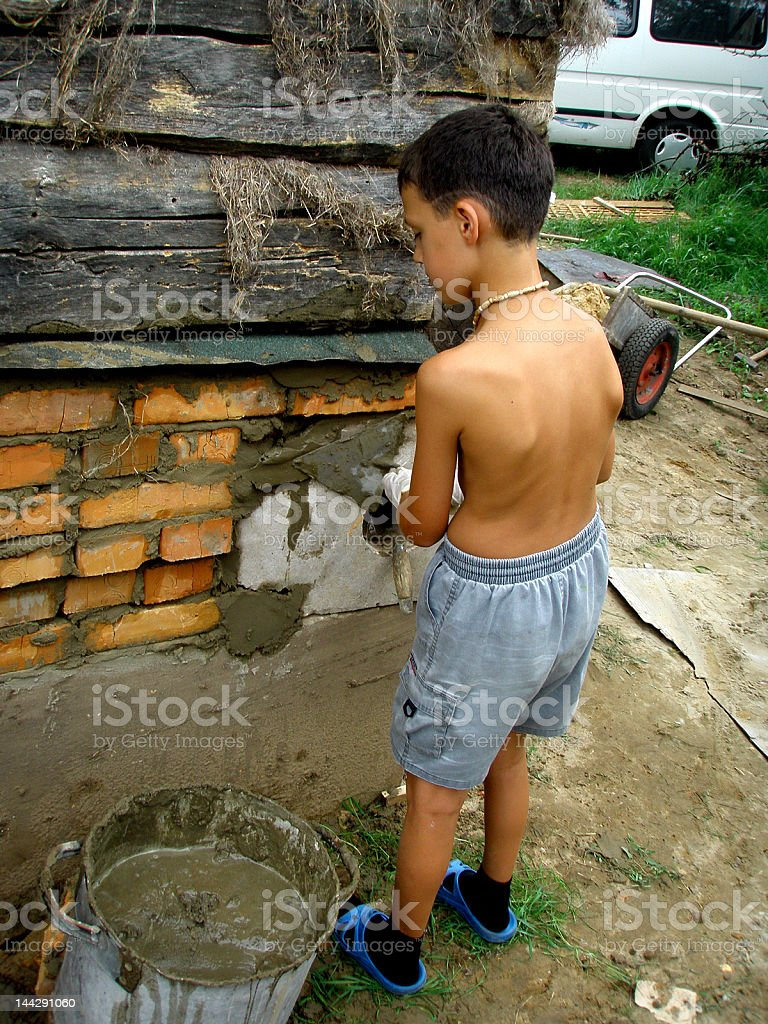 Boy with trowel and cement royalty-free stock photo
