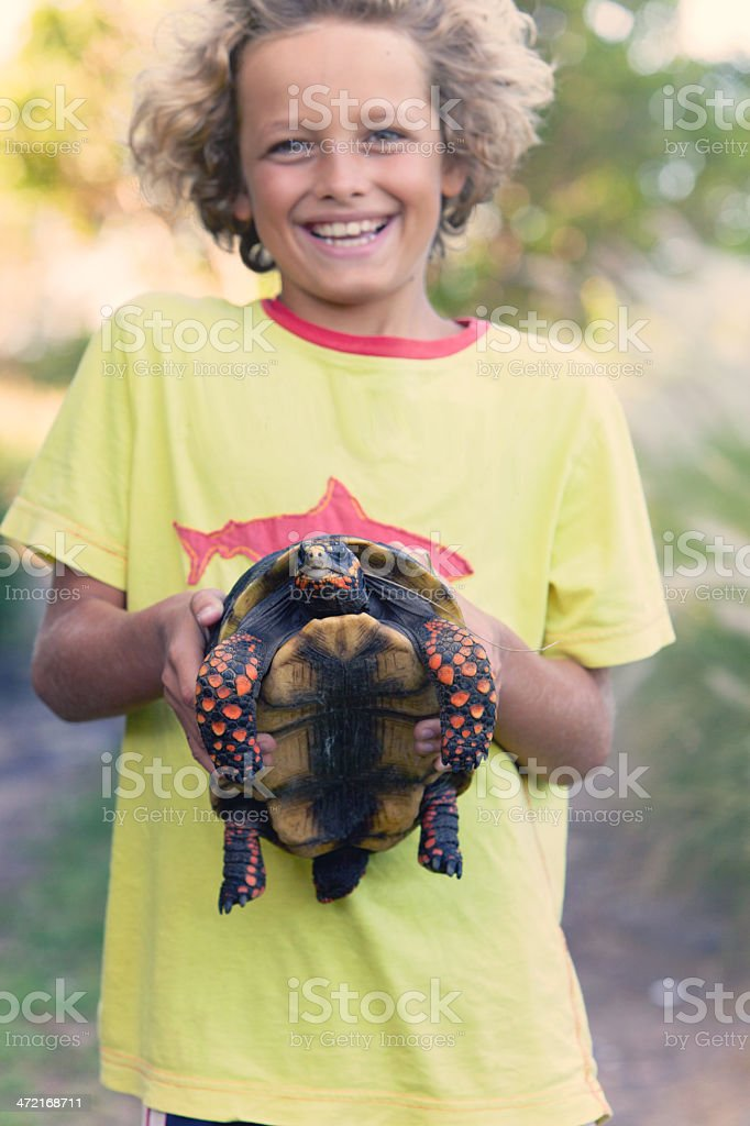 Boy with Turtle stock photo