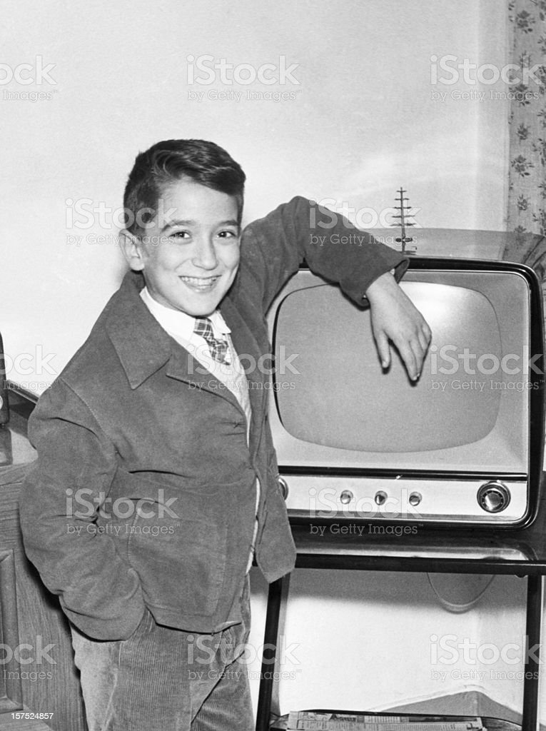 Boy with TV in 1952.Black And White stock photo
