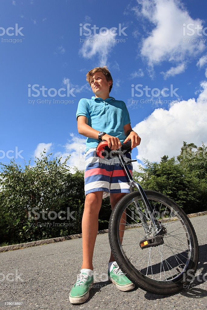 Boy with unicycle royalty-free stock photo