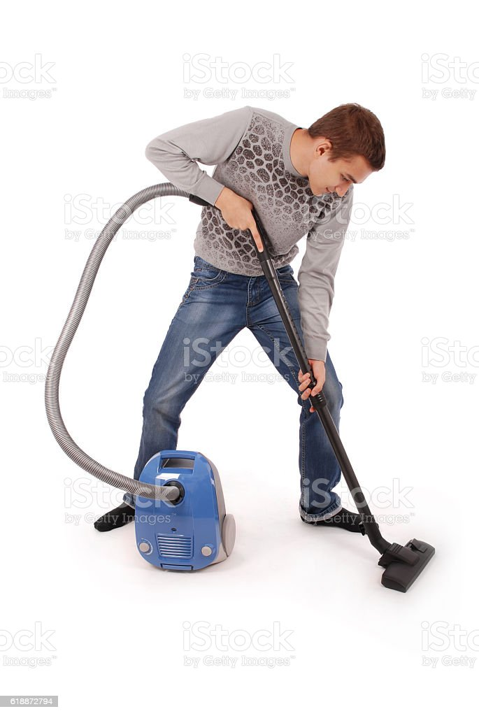 Boy with vacuum cleaner stock photo
