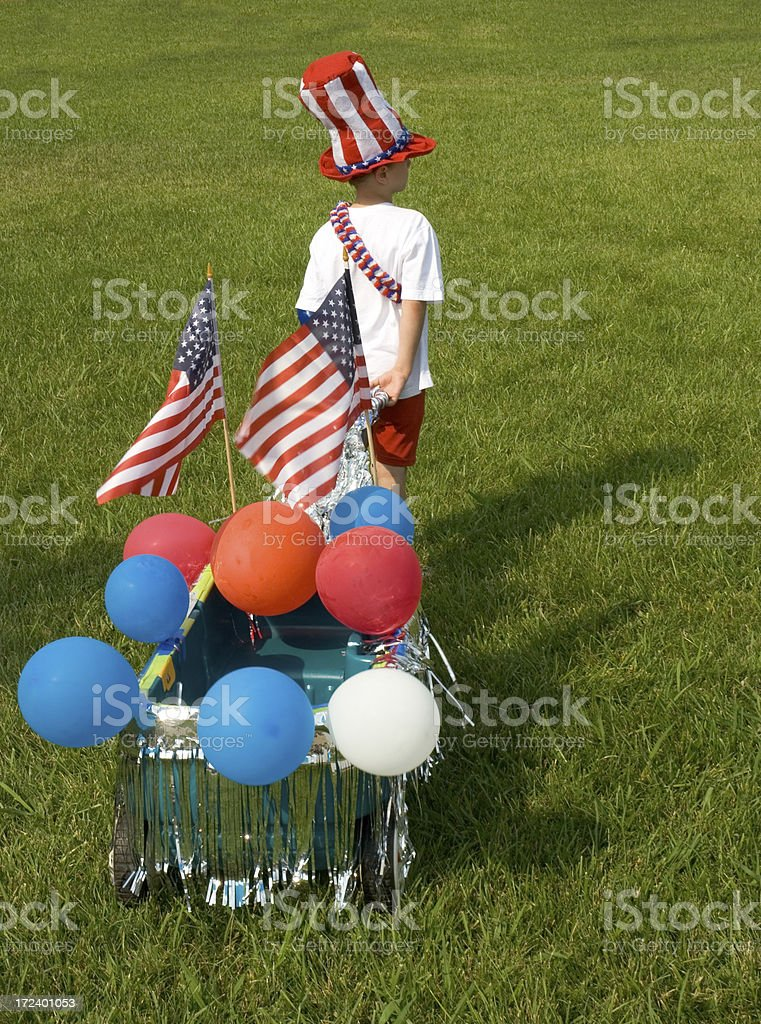 Boy With Wagon Going To 4th Of July Parade royalty-free stock photo