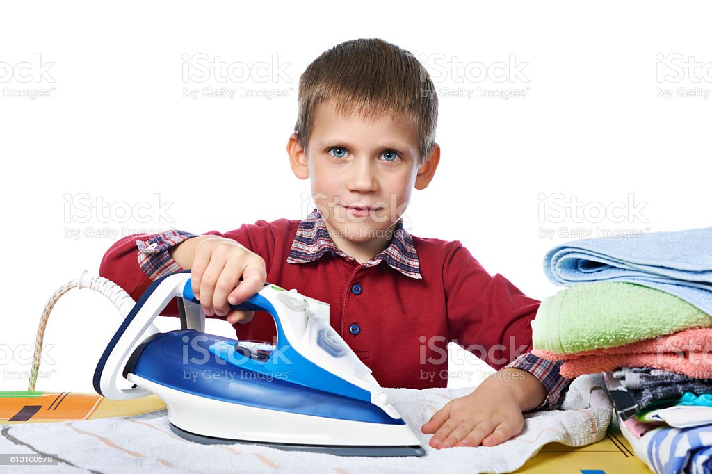 Boy with washed linen and iron isolated stock photo