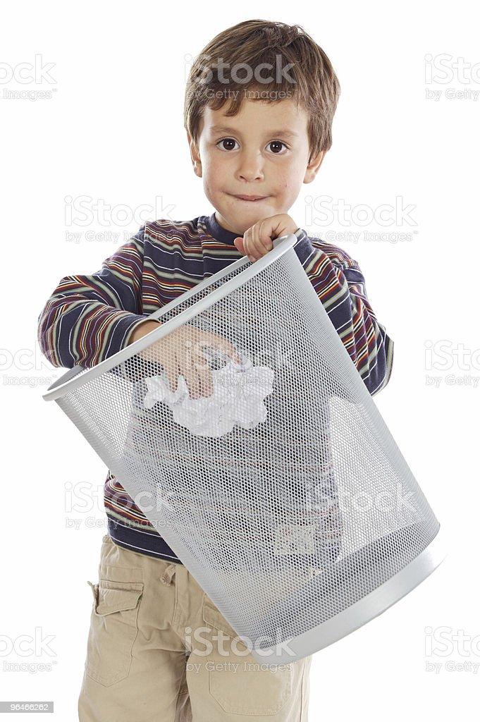Boy with wastebasket stock photo