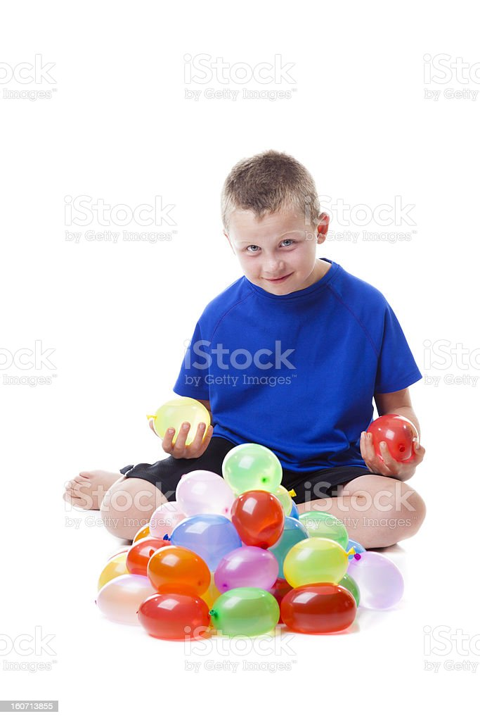Boy with water balloons stock photo