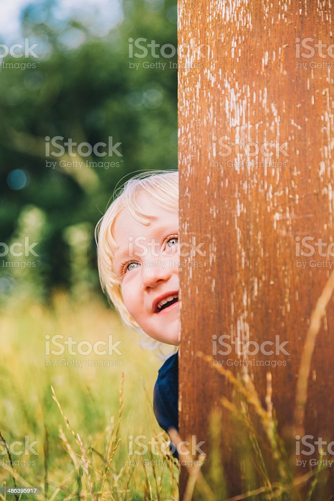 Boy with wooden banner in park stock photo