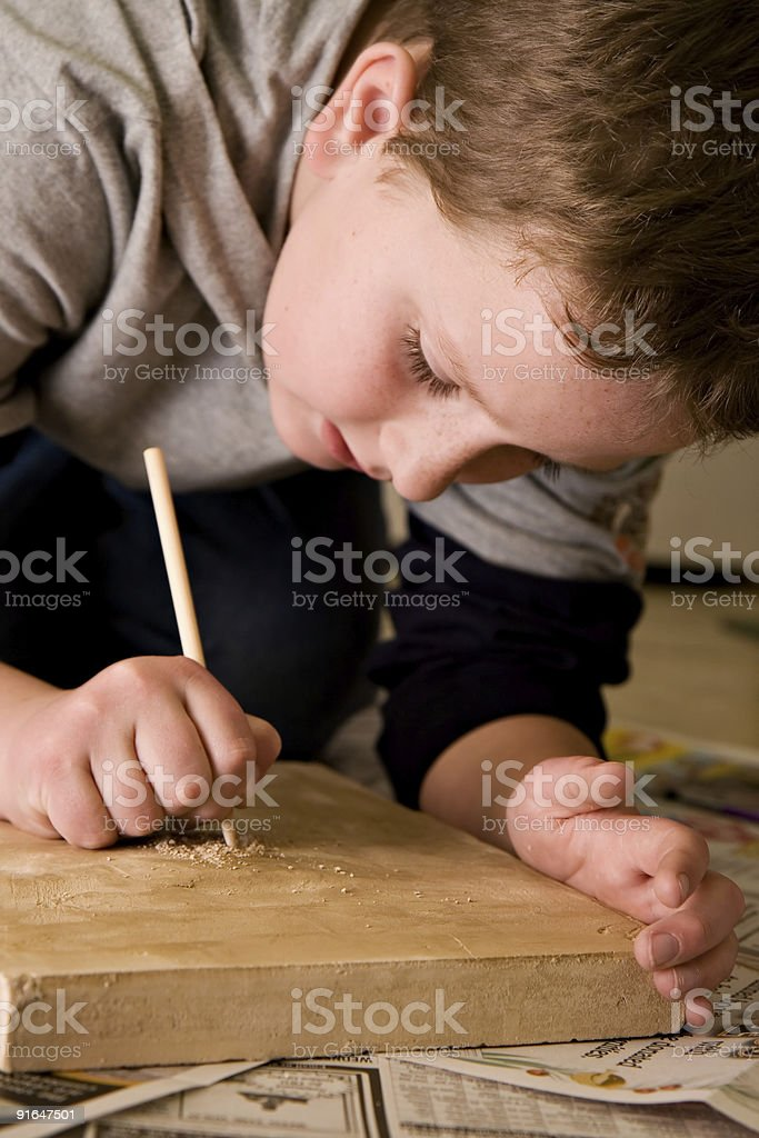 Boy Working Hard on Archaeological Dig royalty-free stock photo