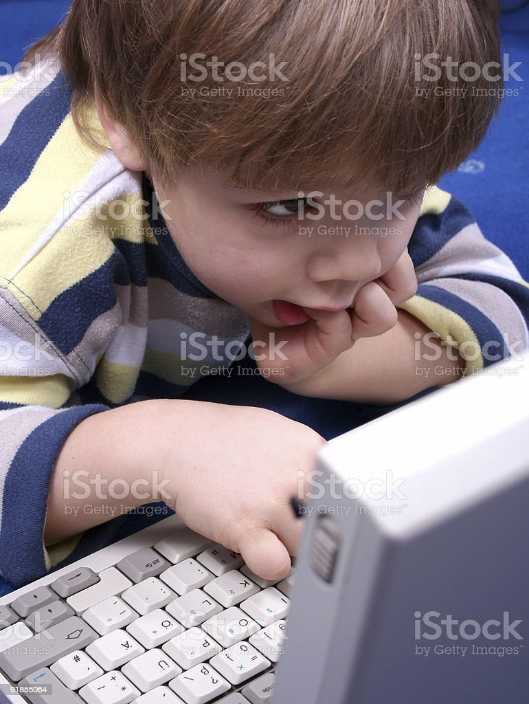 Boy working on a laptop computer royalty-free stock photo