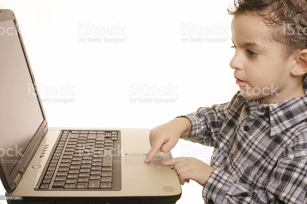 Boy working on a notebook 6 royalty-free stock photo