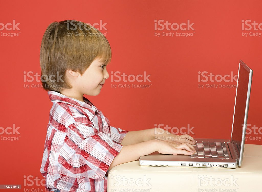Boy working on Laptop computer royalty-free stock photo