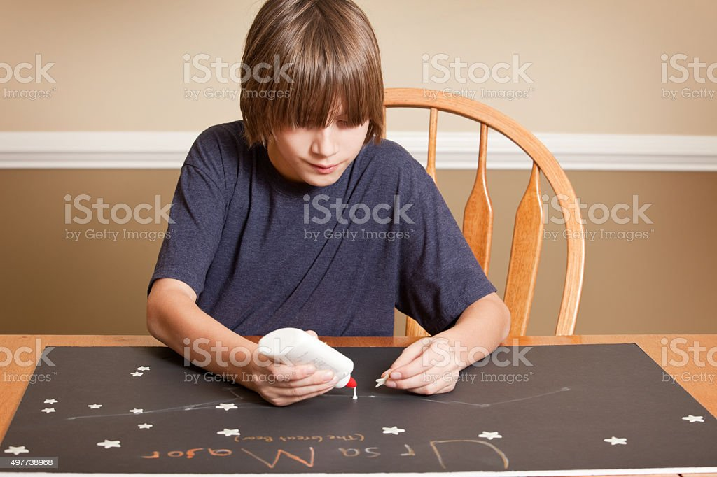Boy Working On Science Project stock photo