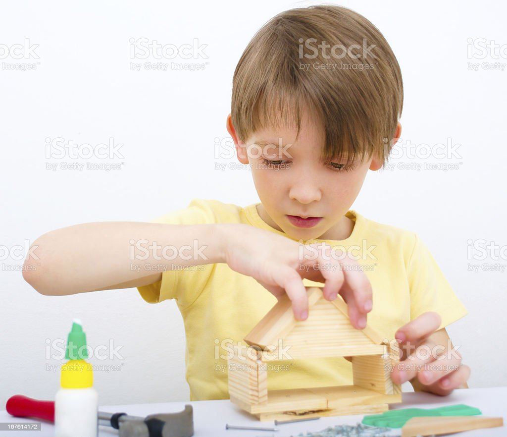 Boy working with hammer and nail royalty-free stock photo