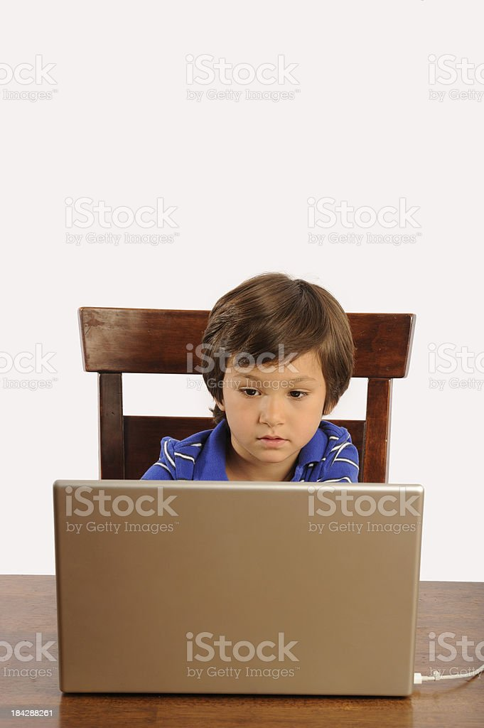 Boy working with laptop. stock photo