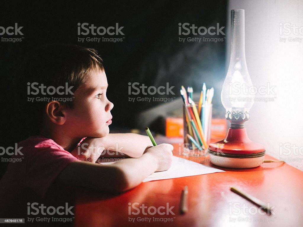 boy writes stock photo