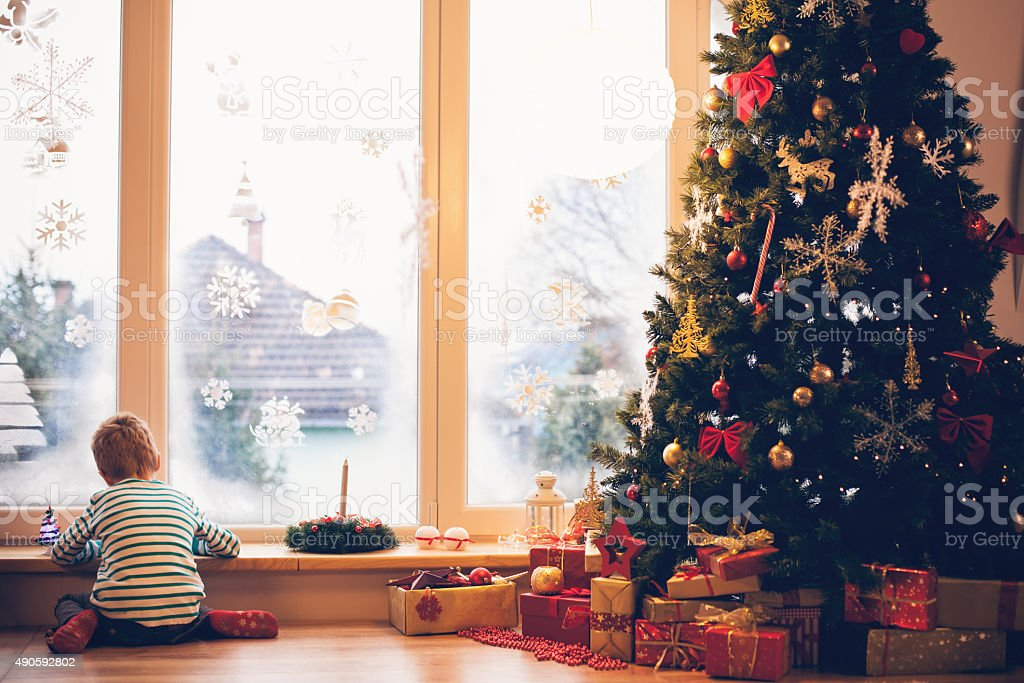Boy writing a letter to Santa for Christmas stock photo