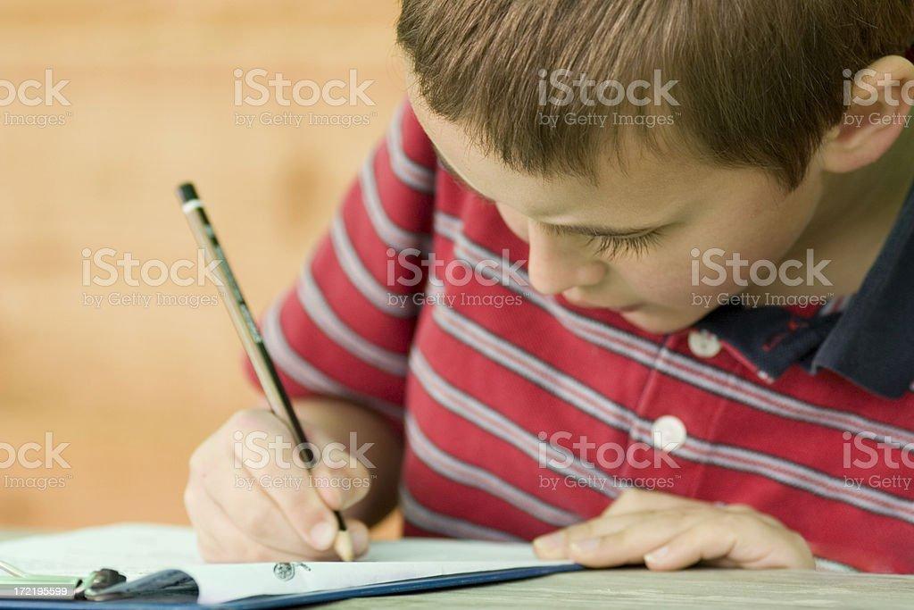 Boy writing royalty-free stock photo