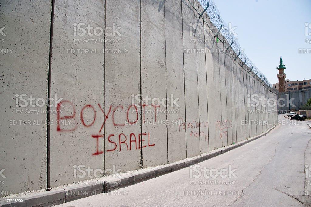 'Boycott Israel' graffiti on Israeli separation wall stock photo