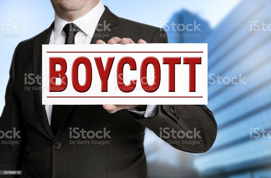 boycott shield is held by businessman stock photo