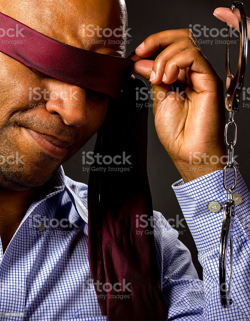 Boyfriend Blindfolded for BDSM with Handcuffs stock photo