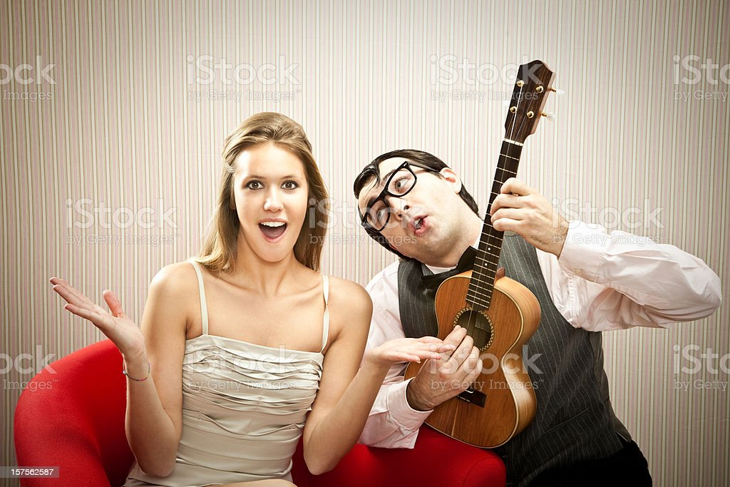 boyfriend play for his girlfriend royalty-free stock photo