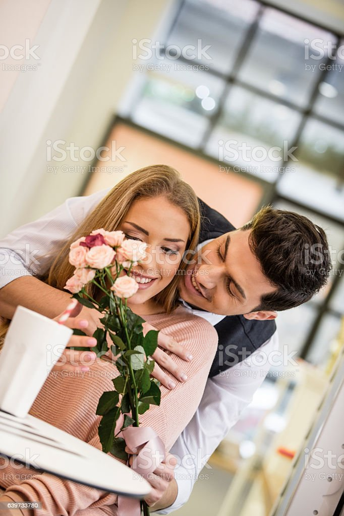 Boyfriend surprises his girl with flowers stock photo